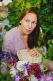 Tender woman resting in grassy thickets with a beautiful bouquet Royalty Free Stock Photos