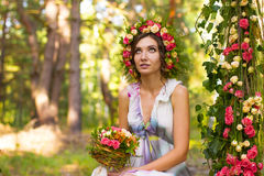 Tender woman in wreath of rose flowers. Royalty Free Stock Images