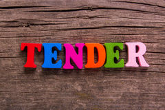 Tender word made of wooden letters Stock Photography