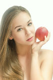 Tender young girl with a peach Stock Photography