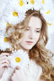 Tender young woman with long curly blond hair Stock Images