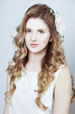 Tender young woman with long curtly blond hair Royalty Free Stock Photos