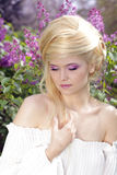 Tender Young woman with violet makeup. Hair style Stock Photos