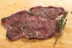 Tenderised rump steak. A tenderised rump steak, coated in olive oil and sprinkled with thyme and pepper Royalty Free Stock Photography