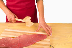 Tenderizing a steak Royalty Free Stock Photography