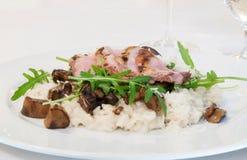 Tenderloin χοιρινού κρέατος με το rissoto στοκ φωτογραφίες
