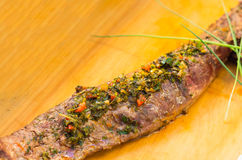 Tenderloin filet perfectly cooked and chimichurri Royalty Free Stock Image