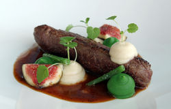 Tenderloin Lamb. With beans and fig stock photos