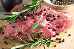 Tenderloin of raw beef with herbs and spices Royalty Free Stock Photos