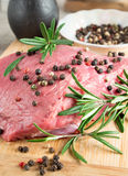 Tenderloin of raw beef with herbs and spices Stock Photos
