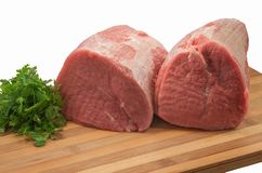 Tenderloin of raw beef with parsley on a wooden board. Isolated Royalty Free Stock Photography