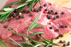 Tenderloin of raw beef with rosemary and pepper Stock Photo