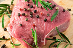Tenderloin raw veal with rosemary and pepper Stock Photography