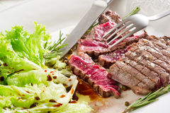 Tenderloin with salad royalty free stock image