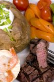 Tenderloin Steak 002. A mouth watering tenderloin steak with fresh vegetables and shrimp Stock Images