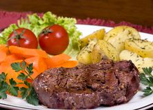 Tenderloin Steak 013. A mouth watering tenderloin steak with fresh vegetables and potatoes Royalty Free Stock Photo