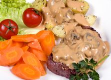 Tenderloin Steak 016. A mouth watering tenderloin steak with fresh vegetables and potatoes with mushroom sauce Stock Image