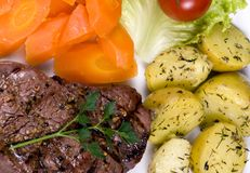 Tenderloin Steak 017. A mouth watering tenderloin steak with fresh vegetables and potatoes Stock Image