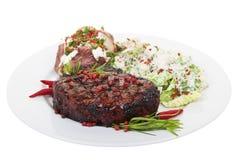 Tenderloin steak. A tenderloin steak dinner isolated on white background stock photos