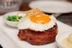 Tenderloin steak with fried egg and green pies Stock Image