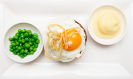 Tenderloin steak with fried egg, potato mash and green pies Royalty Free Stock Photography
