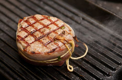 Tenderloin steak on grill Royalty Free Stock Image