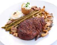 Tenderloin steak mignon-grilled with vegetables Royalty Free Stock Images