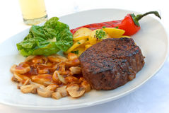 Tenderloin steak mignon-grilled with vegetables.  royalty free stock photography