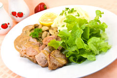 Tenderloin steak with mushroom creme sauce.  Stock Image
