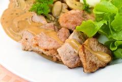 Tenderloin steak with mushroom creme sauce Royalty Free Stock Photo