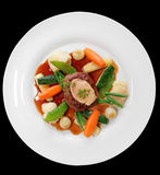 Tenderloin steak with vegetables and bone marrow isolated on bla Royalty Free Stock Photography
