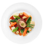 Tenderloin steak with vegetables and bone marrow isolated on whi Stock Photo