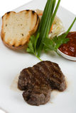 Tenderloin steak on a white plate. Royalty Free Stock Photography