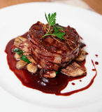 Tenderloin steak wrapped in bacon with red sauce Royalty Free Stock Photography