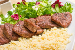 Tenderloin steaks and kuskus groats Stock Image
