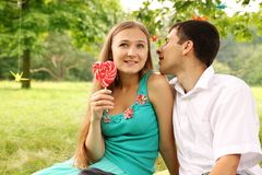 Tenderly whispers. Man tenderly whispers in your women ear Royalty Free Stock Photos