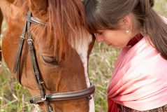 Tenderness. Loving young girl with her horse Stock Photos