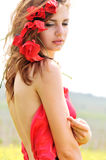 Tenderness. Sweet lady standing with poppies in her hair Stock Images