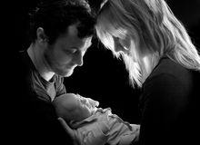 Tenderness. Loving couple holding tenderly their newborn baby Royalty Free Stock Photos