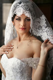 The tenderness bride stands in the room Stock Images