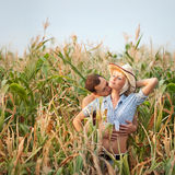 Tenderness in a cornfield. Cowboy hats Royalty Free Stock Images