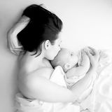 Tenderness and love. Black and white portrait - young mother and her baby sleeping in bed. Tenderness and love Stock Photography