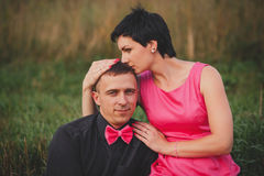 Tenderness and love. beautiful and happy couple in pink Stock Photos