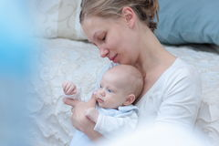 Tenderness mother with baby. Mother looking at  her infant girl Royalty Free Stock Photography