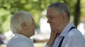 Lovely senior woman kissing her husband stock video