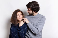 Tenderness and sensuality. A shot of bearded hipster touching tenderly his girl hair. Woman and man in love. Boyfriend move his gi Royalty Free Stock Photography