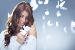 Tenderness. Smiling girl with butterflies in studio Stock Photography