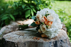 Tenderness wedding bouquet with pink, orange and white roses & w Stock Image
