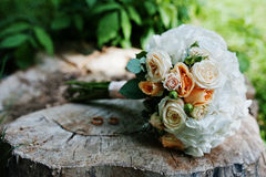 Tenderness wedding bouquet with pink, orange and white roses & w Royalty Free Stock Image