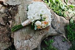 Tenderness wedding bouquet with pink, orange and white roses & w Royalty Free Stock Images